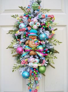 Pastel gingerbread swag for Christmas. http://www.timelessfloralcreations.com/GINGERBREAD-IN-PASTEL-COLORS.html https://www.facebook.com/timelesswreaths