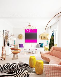 Inside a Groovy Pad Fit for a Queen// peacock, leopard status, houndstooth sofa, zebra hide rug