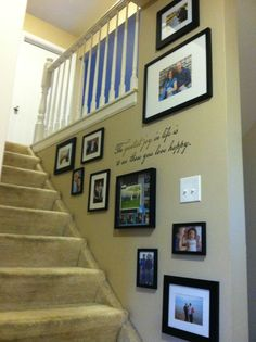 "Photo arrangement for stairwell. Vinyl saying on the wall (found at Kohl's): ""The greatest joy in life is to see those you love happy."" The frames are all 5x7 (some matted, some not), one 8x10 matted frame, and a 12x12 scrapbook page frame (with a scrapbook page inserted)"
