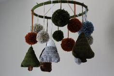 If your little one's nursery theme includes colors and decor in natural elements, then the Woodland Baby Mobile is one item you'll want to create. Trees and pompoms in an assortment of colors combine in this beautiful crochet baby mobile. Crochet Baby Mobiles, Crochet Garland, Crochet Baby Toys, Nursery Patterns, How To Make A Pom Pom, Beautiful Baby Shower, All Free Crochet, Crochet Home Decor, Woodland Baby