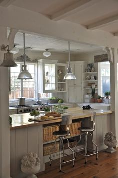 pretty...love the lights above the island and all the windows...the exposed beams are great too!