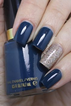 Hello hello! Happy Monday! I have a quick accent mani to share with you all today, using Revlon Fashionista and China Glaze I'm Not Lion. I love the look of a dark polish with one or two glittery ac