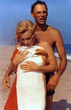 Marilyn & Arthur- From the look on their faces and the fact that the beach was secluded I would guess that some photographer surprised them. She gave so much and the public took so much- never getting enough of her beauty.Poor little girl.You know some cultures believe that to take your photo steals your soul.It causes me to think. With every photo,she gave of herself totally.Only rarely did you see the sadness.She kept that deep inside.