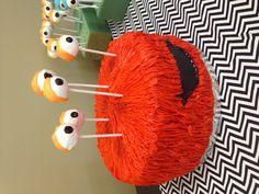 Boy birthday monster cake with cake pop eyes.
