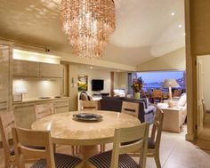 Living room and dining room of Beta Villa Catering, Conference Room, Villa, Dining Room, Chandelier, Ceiling Lights, Lighting, Table, Furniture