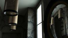 Dans un couloir d'appartement, un papier peint aux motifs originaux et des miroirs aux murs permettent immédiatement d'agrandir l'espace et de lui donner du relief !