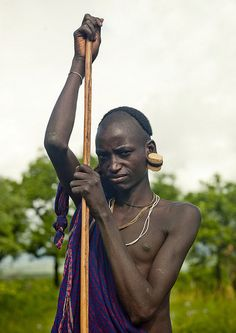 Surma warrior with big ear rings - Ethiopia | © Eric Lafforgue