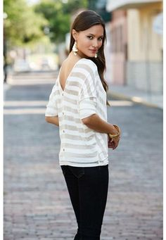 Chevron stripe button back top. Sheer, double v-neck top features ivory and gold lurex stripes and a faux button placket in back. Three quarter sleeves with banded cuffs. Domestic rayon/poly/lurex/spandex. Sizes S, M, L. Gold/ivory (GL). 5465  $19.90. Layering cami not included.