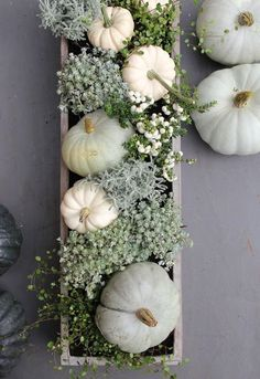 box centerpiece with white pumpkins, greenery and flowers