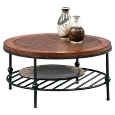 Perfect for a colorful spray of wildflowers and a round of weekend dark and stormys, this handsome coffee table invites industrial-chic style into your living room or den. Finished in a rich tobacco with a gunmetal base and slatted shelf, this must-have design is ideal for storage and display.