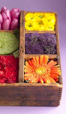 Such a cute way to display your gardens's flowers.  I have a great wooden box like this that I made in 7th or 8th grade.