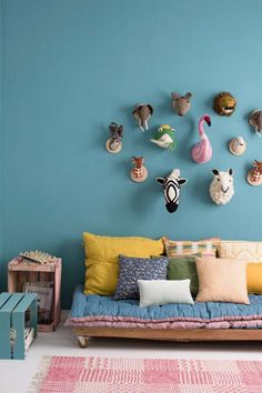 The brighter blue in this room works so well with the mustard too. We're loving the quirky decor, the different shades of blue and pretty much everything in this room.
