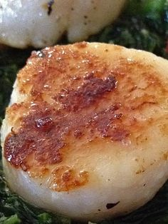 Dinner in 15 minutes: Easy recipe for seared scallops over sautéed spinach with goat cheese. (cow's milk dairy free) and gluten free.