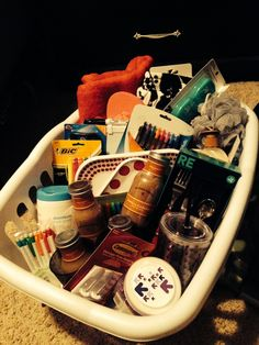 Gift basket for a high school grad going to college! Laundry basket, towel, wash cloths, loofa, body wash, hand soap, floss, tooth paste, flip flops, plates, cups, bowls, utensils, pens, pencils, highlighters, daily planner, white board, dry erase markers, prepared lattes, disinfecting wipes and wall hangers.