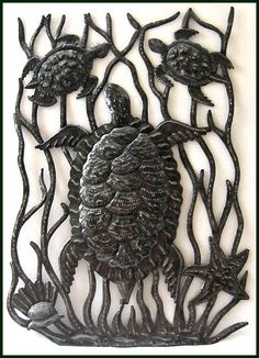 """Haitian Metal Wall Design - Turtles Under the Sea - Haitian Metal Art - 17 x 24""""  Haitian metal art sculpture wall decor for your home or garden. Handcrafted turtle design. Hand cut from recycled steel drums at our workshop in Port au Prince, Haiti.       Steel drum metal art design measures 17"""" x 24"""""""