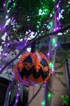 These little pumpkins are awesome! They're a fun and easy way to add some handmade Halloween decor to any part of your house. I hung them in this tree in my fro…