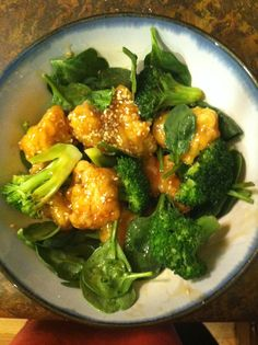 Day 16! Homemade sesame chicken over fresh spinach and steamed broccoli!
