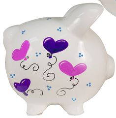 Girls Hand Painted Personailzed Piggy Bank features festive heart shaped balloons. Your little one will love receiving one of our best selling piggy banks for girls. This, too cute, heart balloon design is lovingly hand painted by our staff of professional artists. Name is painted on one