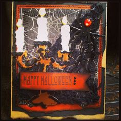 This fun little card is standard size, and spooky! I used Tim Holtz Candlelight Fright Bigz die. I did a quadruple wet embossing technique using 4 different colors of  Zing embossing powders. I hope you like it!