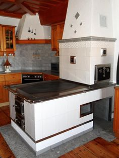 Outdoor Stove, Pizza Oven Outdoor, Kitchen Room Design, Kitchen Interior, Soapstone Stove, Stair Shelves, Antique Stove, Wood Backsplash, Wood Pergola