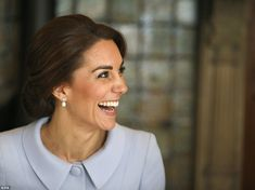 One is amused! The Duchess of Cambridge laughs during a roundtable discussion at the Briti...