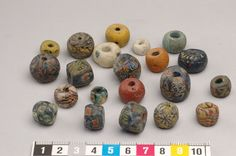 21 Viking age beads, made of glass, some mosaic glass, found in Gotland, Sweden.