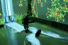Design I/O's 'Funky Forest' is an interactive ecosystem where children create trees with their body and then divert the water flowing from the waterfall to the trees to keep them alive. The health of the trees contributes to the overall health of the forest and the types of creatures that inhabit it.