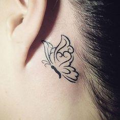 A stylized butterfly portrait is rendered in black ink behind the wearer's left ear in this tattoo. Butterfly Tattoo On Shoulder, Butterfly Tattoos For Women, Butterfly Tattoo Designs, Butterfly Design, Butterfly Outline, Bild Tattoos, Body Art Tattoos, New Tattoos, Tribal Tattoos