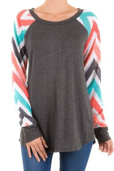 This adorable raglan is calling your name! We are in LOVE with this chevron print. Too cute! Rayon Blend. Made in the USA. Fits true: Small 2/4, Medium 6/8, Large 10/12 ***SHIPS MID NOVEMBER***