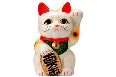 A Maneki Neko, aka a Lucky Cat or Fortune Cat.
