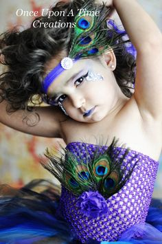 Hey, I found this really awesome Etsy listing at https://www.etsy.com/listing/177520177/couture-peacock-feather-headband-costume