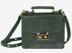 Vintage emerald green bag with a leopard print surprise inside  www.mooreaseal.com