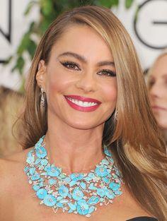 Sofia Vergara accessorized her strapless neckline with a can't-miss, gorgeous floral bib Lorraine Schwartz necklace.