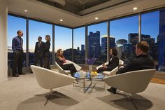 Office design features space for private meetings set against the backdrop of the Boston city skyline. Workplace design. Designed by BH+A.