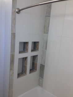 Custom built-in shower storage- www.envisiondesignsd.com