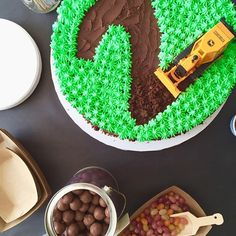 Mmmm, construction theme birthday cake with mini bulldozer and mint icing! So fun and delicious.