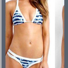 Brand New Royal Blue and white Bikini Brand new 2pc blue and white Striped bikini.. Brand new never worn Sanitation sticker still attached.. Top fits up to DD breast.. Double banded itsy bikini with halter tie back top.. Padded Bikini Swim Bikinis