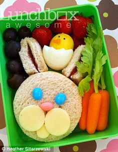 Was this an Easter lunch box? A rabbit and a chicken are decorated by simple berries and carrots with their stems on