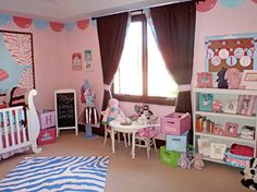 Katy Mimari of Caden Lane designed this pink-and-blue girl's room for former