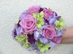 Bride's bouquet-purple toned hydrangea, lavender roses, green dendrobium orchids