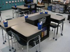 I like the grouping with a bookcase for supplies. It would open up cabinet space for teachers