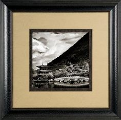 When framing black and white photos or art, you do not always have to use black, white or gray mats. Sometimes warmer neutral mat colors work with the image and may help the framed piece look good in the room where it will be displayed.