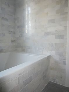 Would love to do a tiled drop-in tub like this, but think it's not happening due to space restrictions.