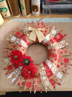 Polystyrene ring covered with 23-24 3 strips of Hobby Craft  Kraft paper-Christmas.