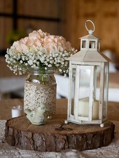 love this. with silver ribbon on mason jar and white hydrangea in the mason jar. maybe even sitting on a blingy silver place mat or runner...