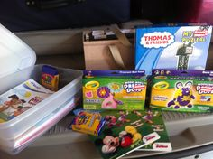 Travel kit for kids: dollar store crayons, coloring books, construction paper, and stickers. I also found dirt cheap foam crafts at Target. Put it all in a plastic container and you're all set.