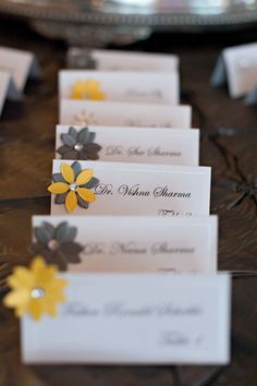 Charcoal & pale yellow, chiavari chairs, uplighting, and whole lotta lovin'. DIY seating cards. Flowers purchased at JoAnns and added to self print cards.