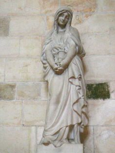 Statue of Mary Magdelene in Basilica of St. Mary Magdalene - Vezelay, France by corsi photo, via Flickr