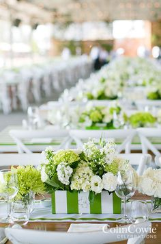 A fresh green and white stripped floral trough overflows with crisp white blooms. Low Centerpieces, Wedding tabletop, Flowers || Colin Cowie Weddings