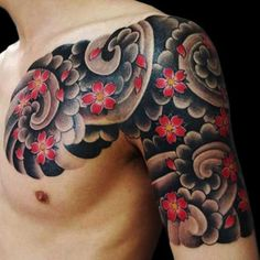 Japanese Flowers Tattoo On Chest And Half Sleeve